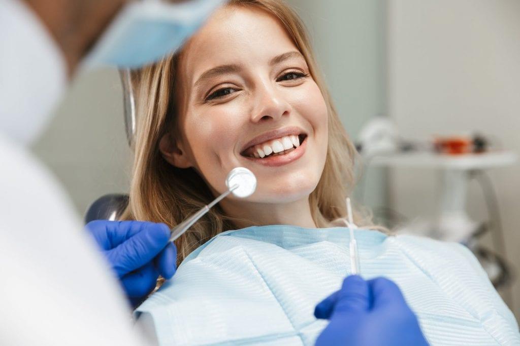 girl in dentist chair getting teeth cleaned