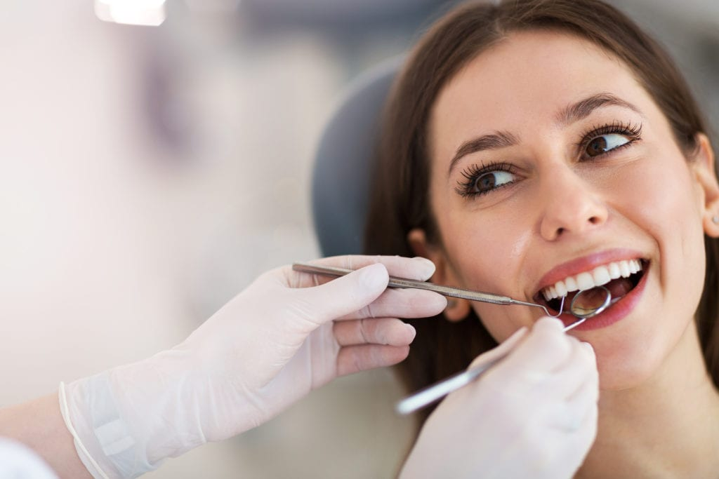 woman getting her teeth cleaned